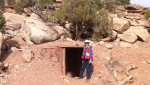 Isabel Barton standing in front of a mine entrance