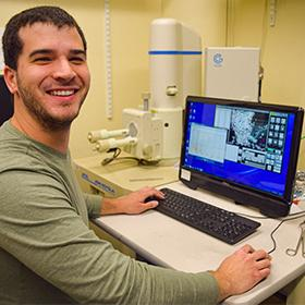 Grad student using the SEM lab