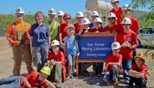 Pam Wilkinson, standing second from left, with visitors to the UA San Xavier Underground Mining Lab, the nation's largest student-run underground mine.
